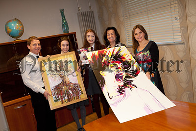 St Pauls students Sarah Jane Ferguson Year 12 and Shauna Murphy Year 13 had art work selected to be published in one of the Uk's largest supplier of art materials catalogue for 2015-2016. Sarah had her work selected as the new cover design and was presented with a voucher for £100 while the school also benefited from a voucher for £150. Pictured with the studebts are Art Teachers Mr Brendan McArdle, Mrs Siobhan O'Hare and Mrs Una McArdle. Missing from picture is Year 14 student Catherine Donnelly. R1503009