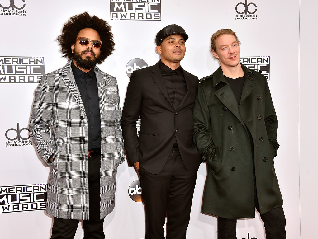 . Jillionaire, from left, Walshy Fire, and Diplo, of Major Lazer, arrive at the American Music Awards at the Microsoft Theater on Sunday, Nov. 20, 2016, in Los Angeles. (Photo by Jordan Strauss/Invision/AP)