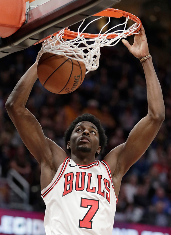 . Chicago Bulls\' Justin Holiday dunks against the Cleveland Cavaliers during the second half of an NBA basketball game Thursday, Dec. 21, 2017, in Cleveland. The Cavaliers won 115-112. (AP Photo/Tony Dejak)
