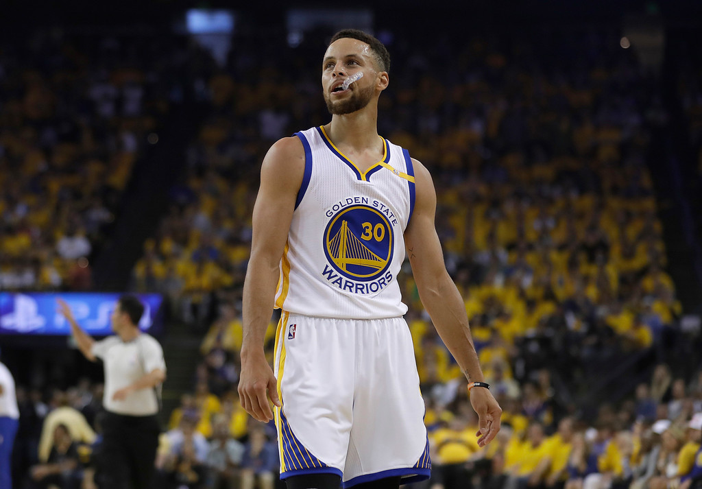 . Golden State Warriors guard Stephen Curry (30) against the Cleveland Cavaliers during the first half of Game 1 of basketball\'s NBA Finals in Oakland, Calif., Thursday, June 1, 2017. (AP Photo/Marcio Jose Sanchez)