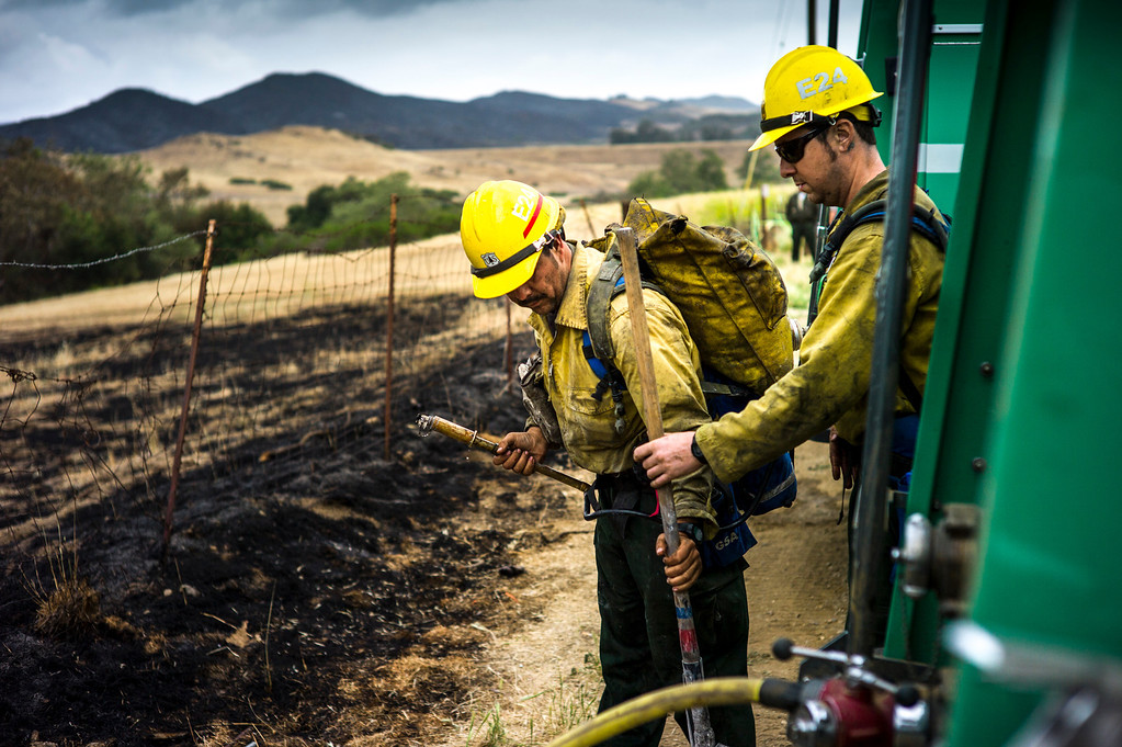 . Forrest service firefighters work on the last remaining hot spots of the Spring fire off of Protrero road near Hidden Valley Sunday.  Cool damp weather has helped crews begin to get the upper hand on the fire which has burned more than 10,000 acres.  Photo by David Crane/Los Angeles Daily News.