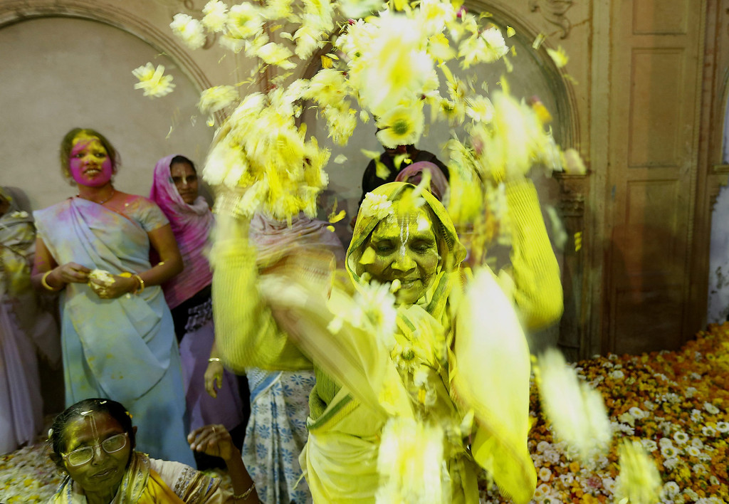 . An Indian widow throws petals while participating in the Holi festival in Vrindavan, Uttar Pradesh, India, March 14, 2014.  EPA/HARISH TYAGI