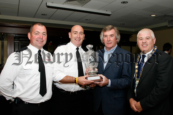 Chernobyl Aid North patron Pat Jennings makes a presentation to Newry Fire & Rescue Service  for their continuous time and effort fund raising for  Chernobyl Aid North, accepting the award are Steven Mc Guigan and Kevin Mc Donnell , also included is Michael Cole (mayor).06W31N52