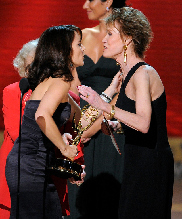 ". Producer and star Tina Fey, is congratulated by presenter, Mary Tyler Moore, after she accepted the award for outstanding comedy series ""30 Rock\"" at the 60th Primetime Emmy Awards Sunday, Sept. 21, 2008, in Los Angeles. (AP Photo/Mark J. Terrill)"