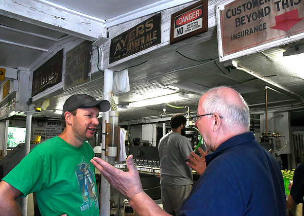 7/7/2018 Mike Orazzi | Staff Connecticut Senator Chris Murphy (left) while talking to Avery Beverage Manager Rob Metz during part of this walking tour of the state Saturday.