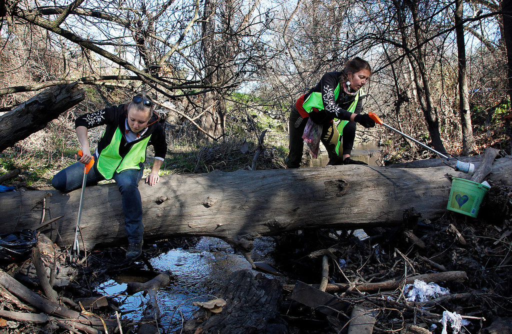 . Save Our Shores staffers Dayna Zimmermann, left, and Rachel Kippen, participate in a clean-up of Coyote Creek near the Highway 280 overpass and Selma Olinder Park, in San Jose, Calif. on Saturday, Feb. 9, 2013.   (LiPo Ching/Staff)