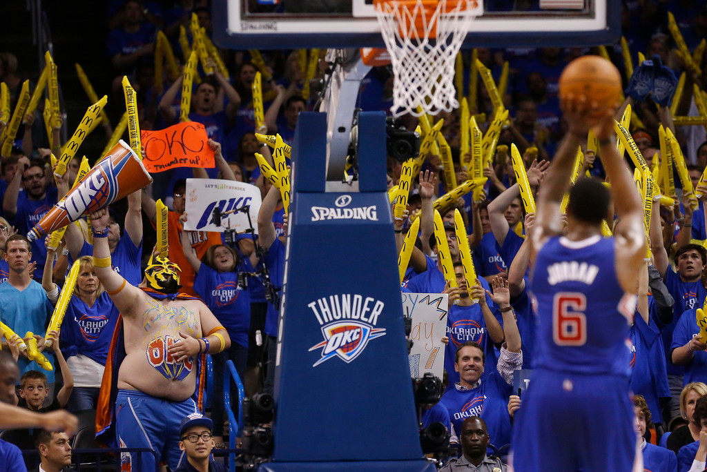 . Oklahoma City Thunder fans try to distract Los Angeles Clippers center DeAndre Jordan (6) as he shoots a foul shot in the third quarter of Game 1 of the Western Conference semifinal NBA basketball playoff series in Oklahoma City, Monday, May 5, 2014. Los Angeles won 122-105. (AP Photo/Sue Ogrocki)