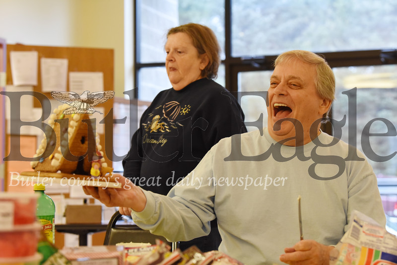 Harold Aughton/Butler Eagle: Bob Demask of Evans City proudly displays his gingerbread house at the Evans City Senior Center, Tues., Dec. 3, 2019.
