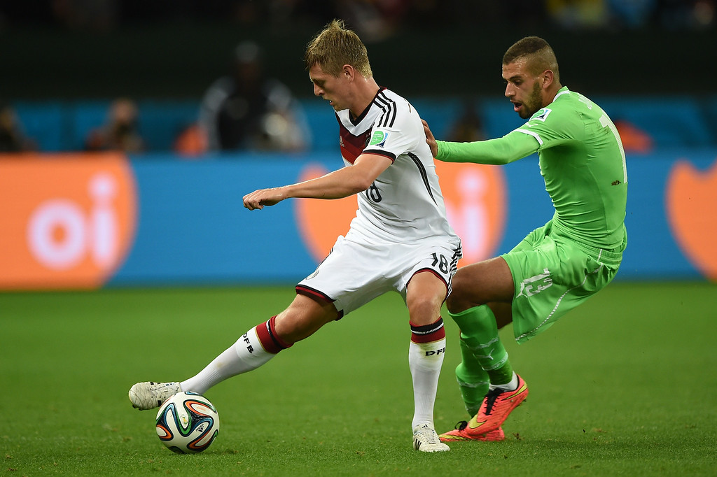 . Germany\'s midfielder Toni Kroos (L) and Algeria\'s forward Islam Slimani vie for the ball  during a Round of 16 football match between Germany and Algeria at Beira-Rio Stadium in Porto Alegre during the 2014 FIFA World Cup on June 30, 2014.  KIRILL KUDRYAVTSEV/AFP/Getty Images