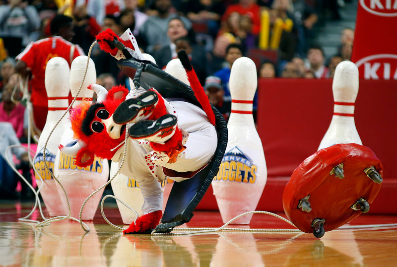 ". Chicago Bulls mascot ""Bennie the Bull\"" collides with fake bowling pins during a time-out of a pre-season NBA basketball game in Chicago, on Monday Oct. 13, 2014. The Bulls won the game 110-90. (AP Photo/Jeff Haynes)"