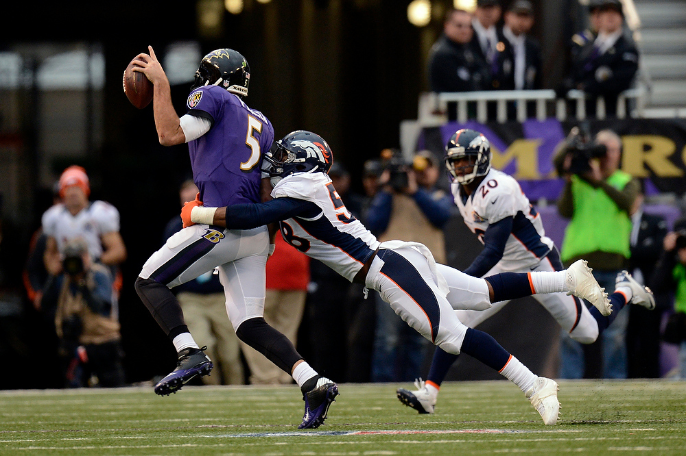 . Denver Broncos outside linebacker Von Miller #58 gets to Baltimore Ravens quarterback Joe Flacco #5 in the second half at the M&T Bank Stadium, in Baltimore, MD Sunday December 16, 2012.      Joe Amon, The Denver Post
