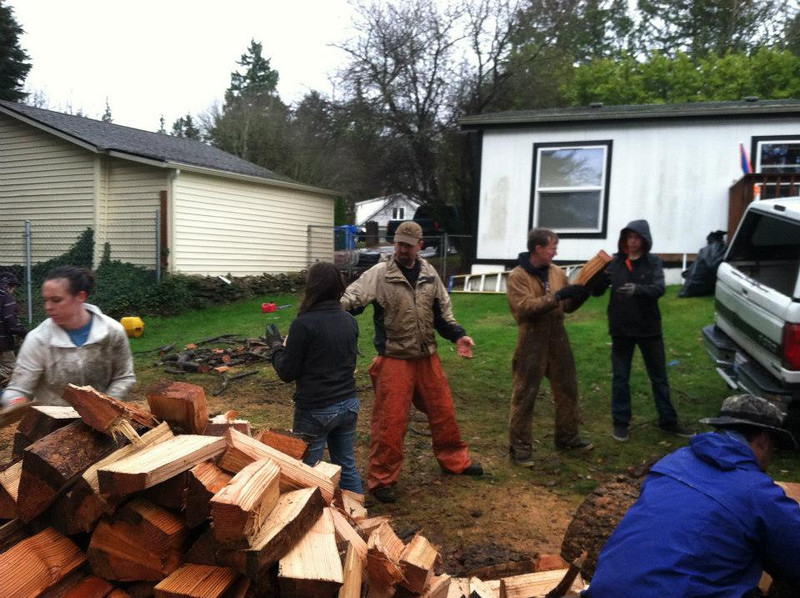 ekklasia loading wood for food bank.jpg