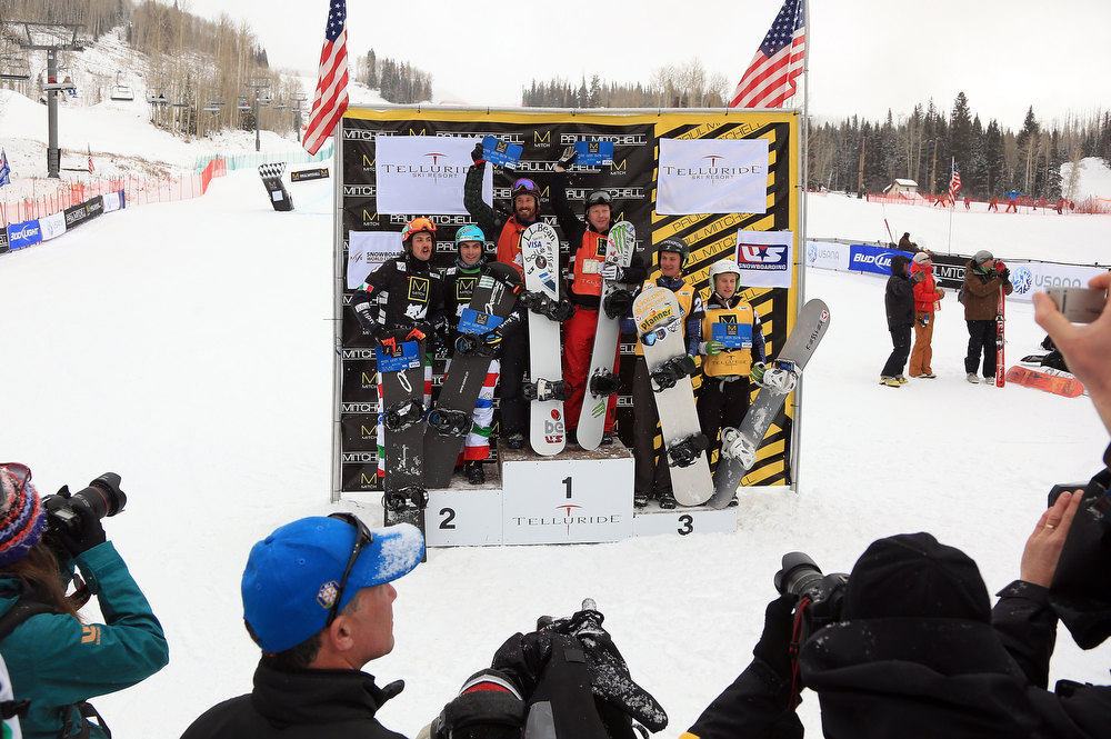 . (L-R) Tomaso Leoni and Emanuel Perathoner of Italy in second place, Seth Wescott and Nate Holland of the USA in first place, Michael Haemmerle and Hanno Douschan of Austria in third place take the podium for the USANA Snowboardcross World Cup Team Event on December 15, 2012 in Telluride, Colorado.  (Photo by Doug Pensinger/Getty Images)
