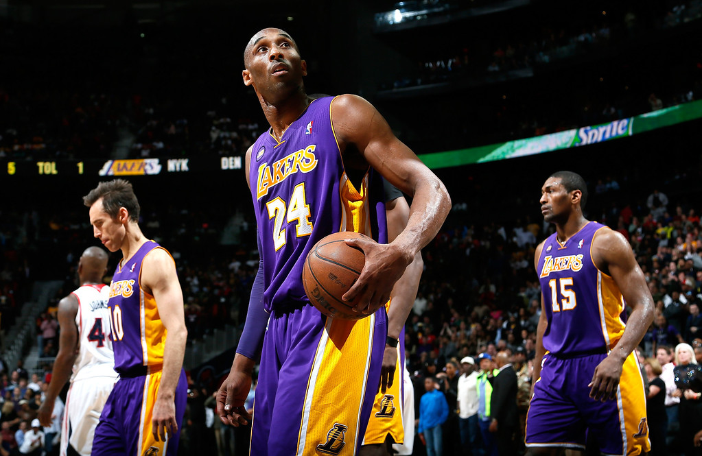 . ATLANTA, GA - MARCH 13:  Kobe Bryant #24 of the Los Angeles Lakers walks off the court after an Atlanta Hawks basket and a timeout in the final seconds at Philips Arena on March 13, 2013 in Atlanta, Georgia.  NOTE TO USER: User expressly acknowledges and agrees that, by downloading and or using this photograph, User is consenting to the terms and conditions of the Getty Images License Agreement.  (Photo by Kevin C. Cox/Getty Images)