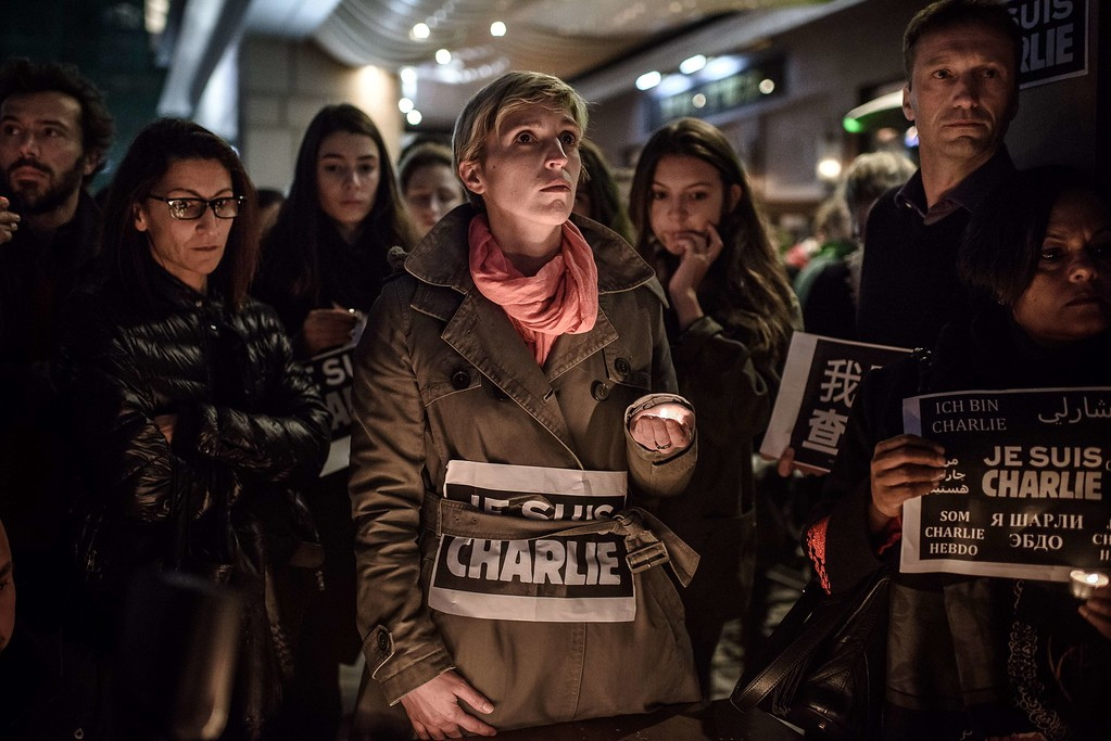 ". French nationals attend attend a vigil in solidarity with the victims of the shooting at the Paris office of the satirical newspaper Charlie Hebdo in Hong Kong on January 8, 2015. The UN Security Council led global condemnation of the ""terrorist\"" shooting at French magazine Charlie Hebdo which left 12 people dead, in a shocking attack on freedom of speech in Europe. AFP PHOTO / Philippe  LOPEZ/AFP/Getty Images"