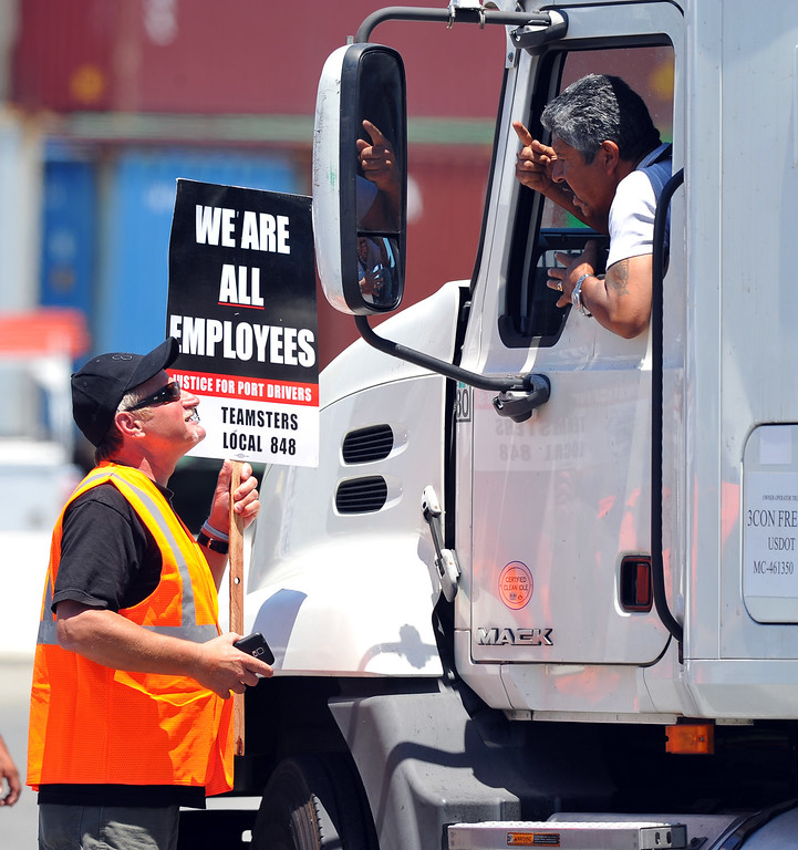 . A trucker who was delayed by picketers from entering the Evergreen terminal argues with striking truckers on Terminal Island, CA on Wednesday, July 9, 2014.  (Photo by Scott Varley, Daily Breeze)