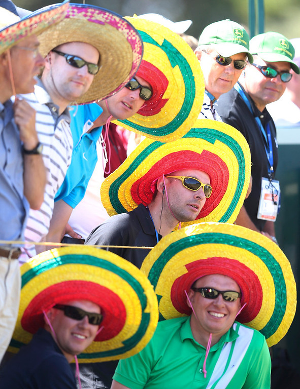 . Spectators wearing colorful hats watch the play on the 14th hole during the second round of the British Open Golf Championship at Muirfield, Scotland, Friday July 19, 2013. (AP Photo/Scott Heppell)