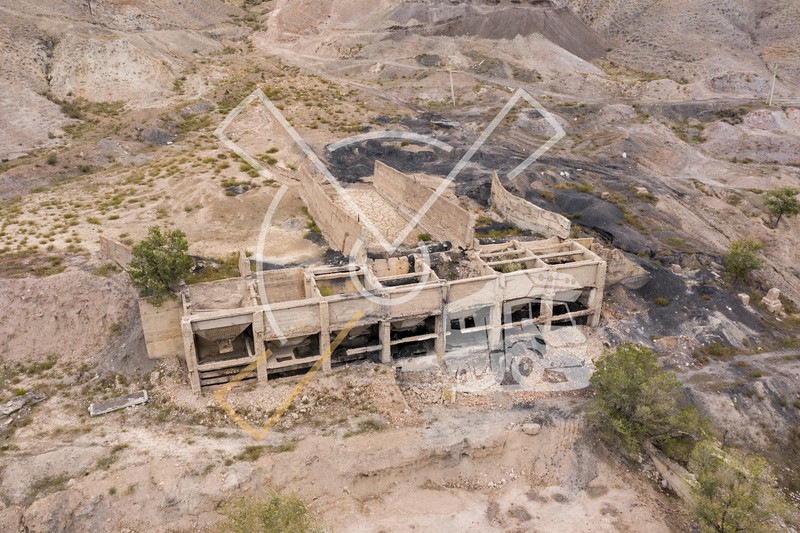 Aerial image showing the abandoned ruins of a former Soviet factory in the uranium mining city of Ming Kush