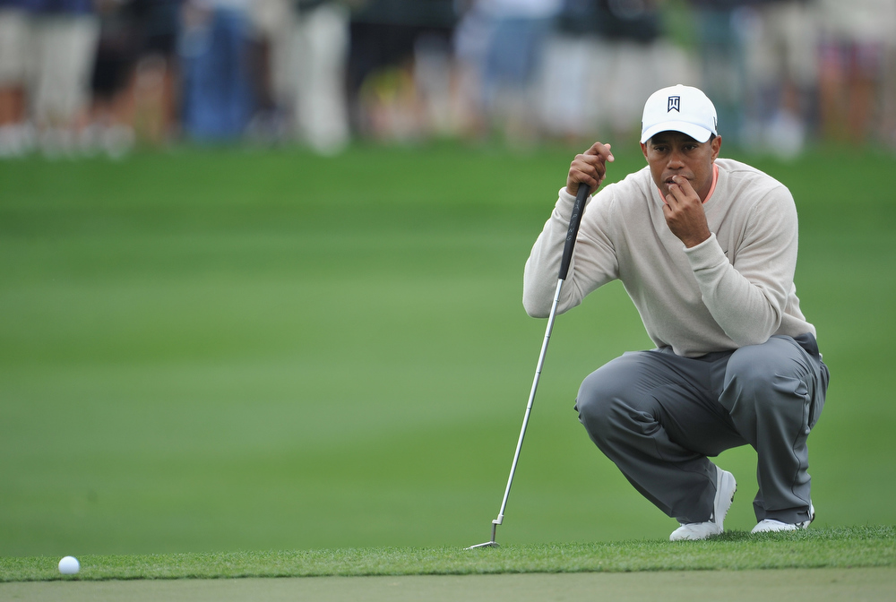 . Tiger Woods of USA ponders his putt on the sixth hole during the first round of the Honda Classic on February 28, 2013 in Palm Beach Gardens, Florida.  (Photo by Stuart Franklin/Getty Images)