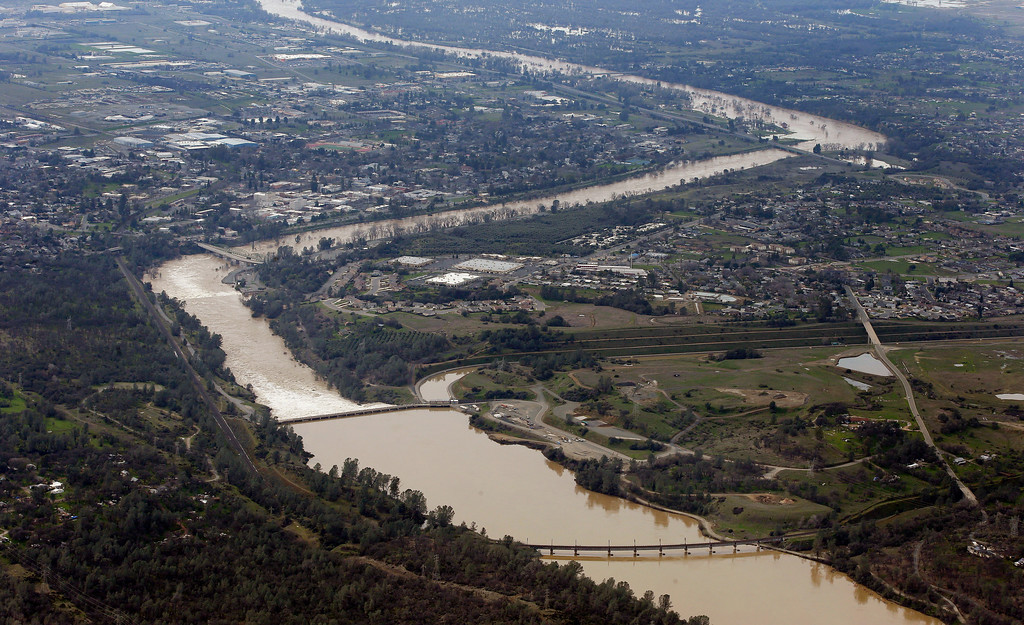 . The water from the Feather River flows through Oroville, Calif., Monday, Feb. 13, 2017. Water levels at Lake Oroville, which feeds the river are continuing to drop, stopping water from spilling over the spillway. Thousands of Northern California residents were asked to evacuate their homes Sunday evening after authorities warned the emergency spillway of the Oroville Dam could fail at any time unleashing uncontrolled flood waters on towns below. (AP Photo/Rich Pedroncelli)