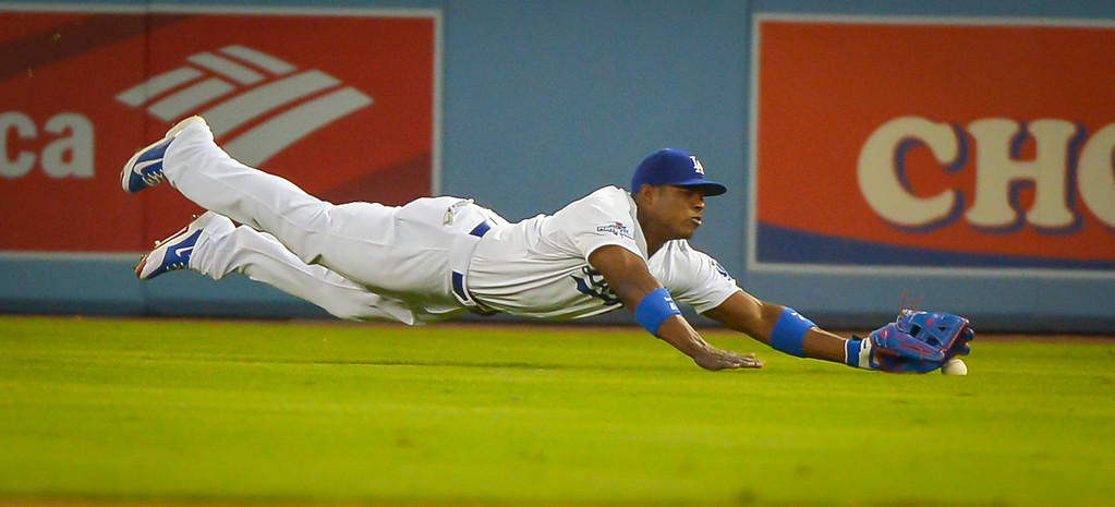 . Dodgers\' Yasiel Puig couldn\'t get to this ball against the Cardinals in NLCS game 3 at Dodger stadium Monday, October 14, 2013 ( Photo by Andy Holzman/Los Angeles Daily News )