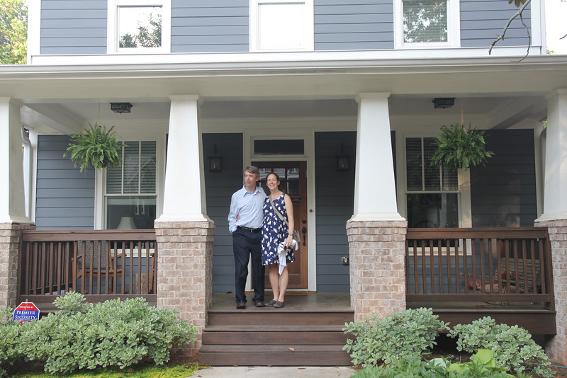 Anne & Trey in front of their new home