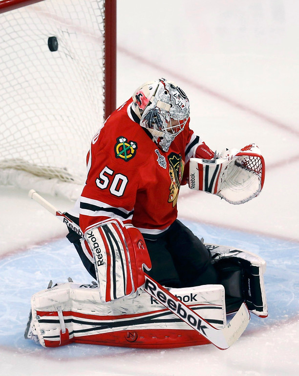 . Chicago Blackhawks goalie Corey Crawford lets in a goal by Boston Bruins\' Milan Lucic (not pictured) during the second period in Game 1 of their NHL Stanley Cup Finals hockey game in Chicago, Illinois, June 12, 2013. REUTERS/Jim Young