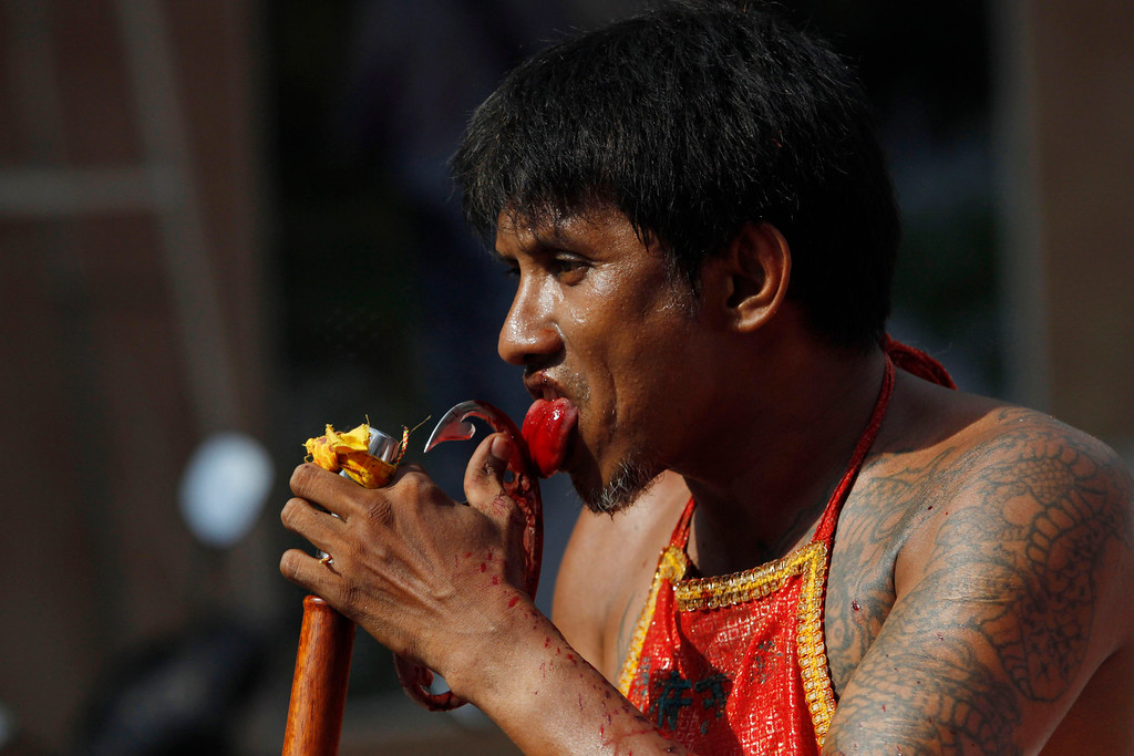 . A vegetarian festival devotee parades through the streets on September 29, 2014 in Phuket, Thailand.  (Photo by Borja Sanchez-Trillo/Getty Images)