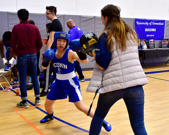 3/16/2019 Mike Orazzi | Staff UConns Corona Zhang (blue) before a 115 match with West Points Ahliyah Lablue (red) during the National Collegiate Boxing Association National Qualifier held at the Bristol Boys & Girls Club in Bristol, Conn. on Saturday.