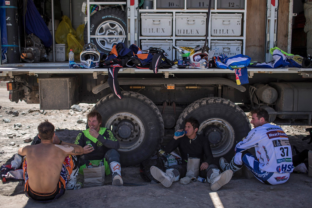 . Dakar motorcycle competitors rest before the start of fourth stage special during the Dakar Rally 2015 between Chilecito, Argentina and Copiapo, Chile, Wednesday, Jan. 7, 2015. The race will finish on Jan. 17, passing through Bolivia and Chile before returning to Argentina where it started. (AP Photo/Felipe Dana)