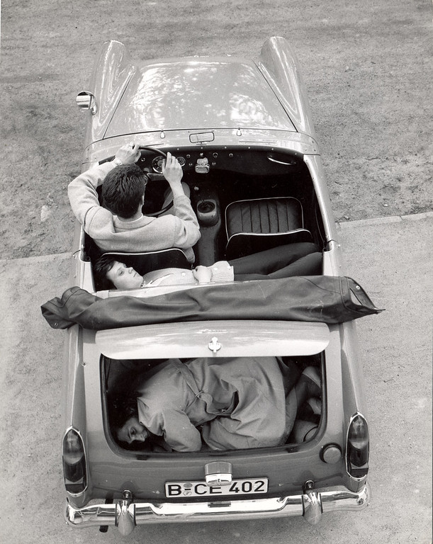. Heinz Meixner with his fiancee and her mother Frau Thurau, show how they arranged themselves in his Austin-Healey Sprite to drive through the Berlin Wall, Germany, circa 1965. (Photo by Express Newspapers/Getty Images)