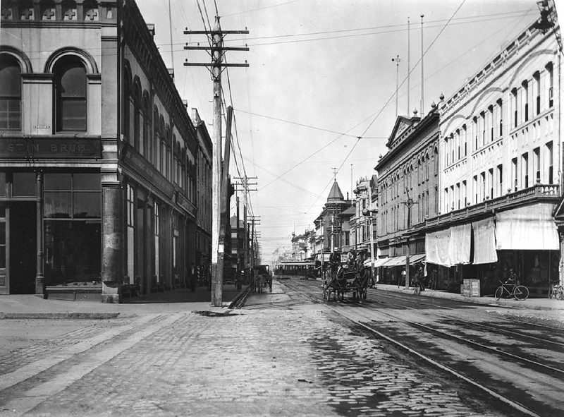 View of the corner of Main Street and American Street, looking west on Main Street, ca.1900