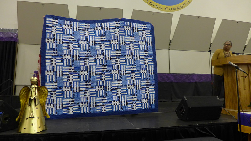 Toya Owens showed us a quilt she made for her pastor.  She started this at the retreat.  She had previously sworn off making anything with 1 1/2 inch strips.  Quilted by Jan Johnson.