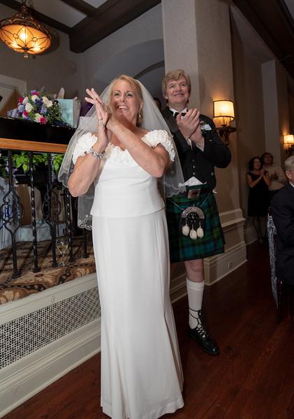 Bride and Groom Watching irish dancers.jpg