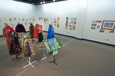 Art Gallery with Clothing and Paintings