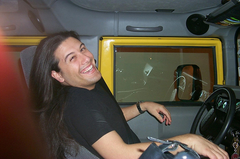 Here I am just laughing away in the Hummer.  Hey, that's a Quake keychain!