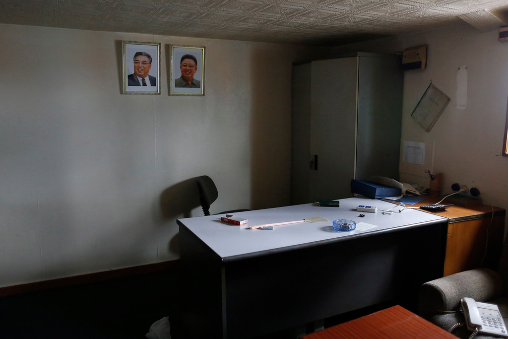 """. Portraits of former leader Kim Jong-il (R) and former president Kim Il-sung are seen in one of the rooms inside a North Korean flagged ship \""""Chong Chon Gang\"""" docked at the Manzanillo Container Terminal in Colon City July 16, 2013.  REUTERS/Carlos Jasso"""
