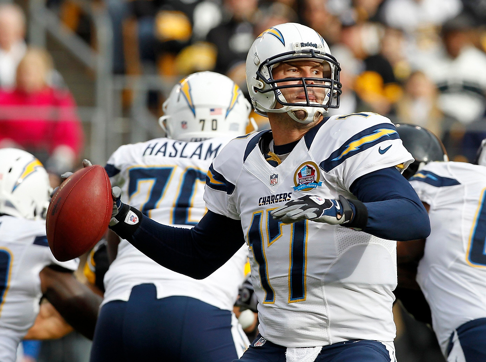 . San Diego Chargers quarterback Phillip Rivers looks to pass against the Pittsburgh Steelers in the second quarter of their NFL football game in Pittsburgh, Pennsylvania, December 9, 2012. REUTERS/Jason Cohn
