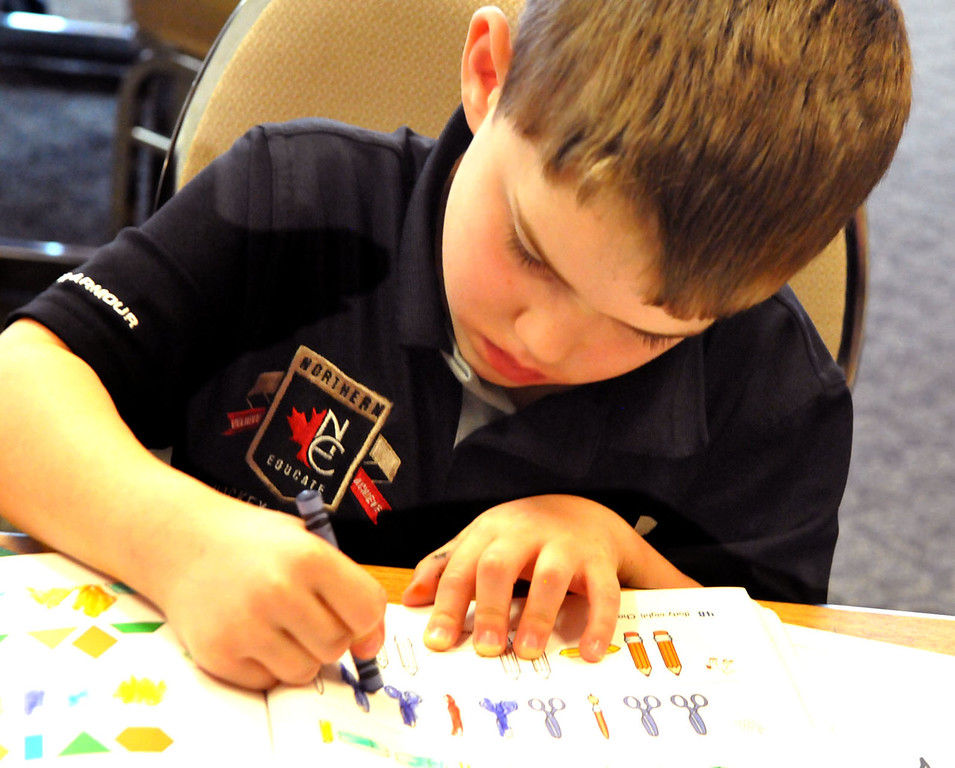 . Kindergartener Colt Black colors in a workbook during class at Northern Educate Hockey Academy.  (Pioneer Press: John Doman)