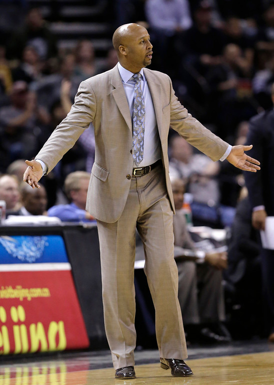 . Denver Nuggets coach Brian Shaw questions a call during the second half of an NBA basketball game against the San Antonio Spurs, Wednesday, March 26, 2014, in San Antonio. San Antonio won 108-103. (AP Photo/Eric Gay)