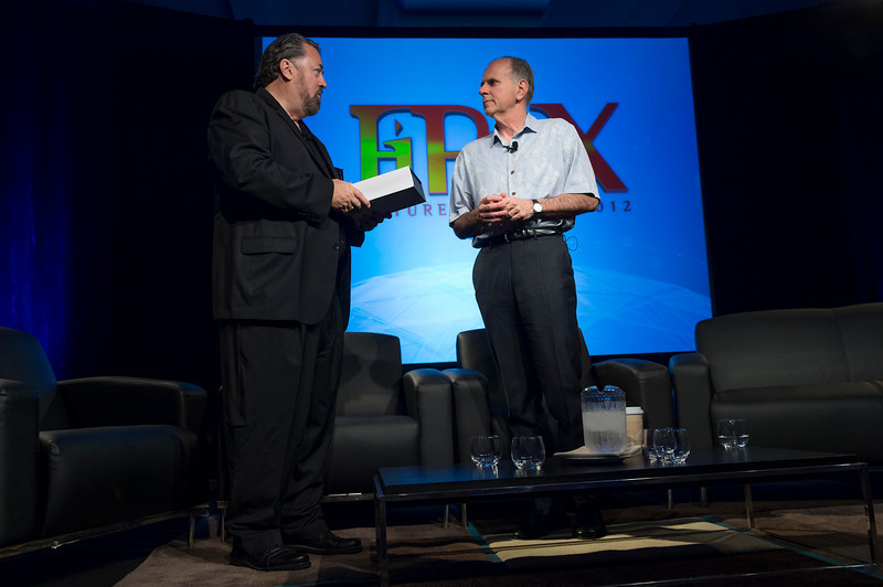 """Mark Anderson (L) presents Nuance Communications CEO Paul Ricci with the FiRe X """"Company of the Yearr"""" award.   May 22-25, 2012: At the Montage in Laguna Beach, CA, 200 thought leaders - high technology engineers and executives, entrepreneurs, scientists, and media professionals - gathered for 3 days to participate in FiRe X, the 10th annual Future in Review conference, presented by the Strategic News Service and led by SNS founder and technology visionary Mark Anderson. Interviews, panel discussions, and informal conversations ranged from IP protection to CO2 and climate change, new healthcare paradigms, global economics, ocean toxins, robotics, documentary filmmaking,  medical diagnostics, technology solutions for social issues, global economics, mobile computing, and tech solutions to human trafficking and aging with dignity."""