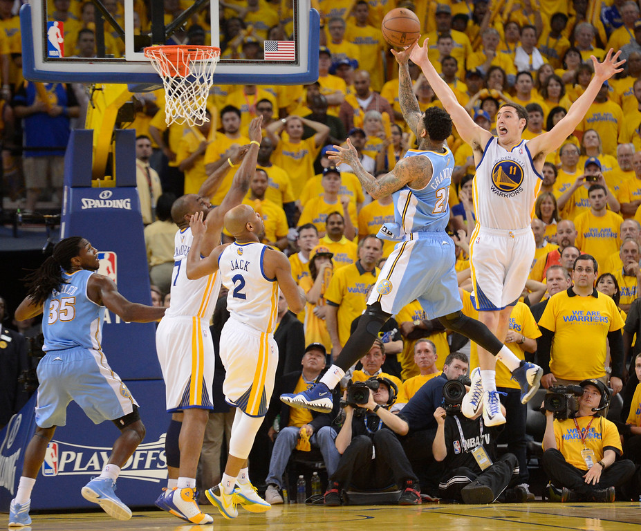 . Wilson Chandler (21) of the Denver Nuggets takes a shot with 00:12.9	over Klay Thompson (11) of the Golden State Warriors and missed in Game 6 of the first round NBA Playoffs May 2, 2013 at Oracle Arena. (Photo By John Leyba/The Denver Post)