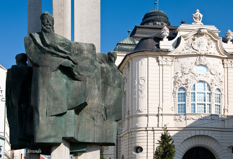 Memorial statue in Bratislava next to a nicely restored building