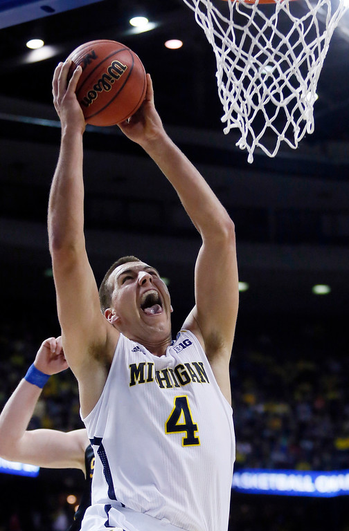 . Michigan forward Mitch McGary (4) goes up to dunk against South Dakota State in the first half of a second-round game of the NCAA men\'s college basketball tournament Thursday, March 21, 2013, in Auburn Hills, Mich. (AP Photo/Duane Burleson)