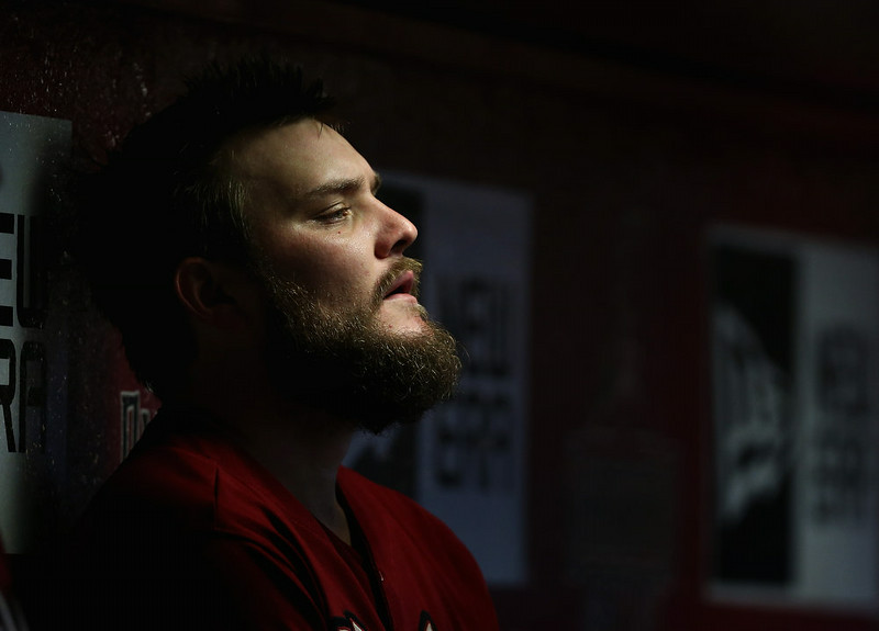 . Starting pitcher Wade Miley #36 of the Arizona Diamondbacks watches from the dugout during the MLB game against the Colorado Rockies at Chase Field on August 10, 2014 in Phoenix, Arizona.  (Photo by Christian Petersen/Getty Images)