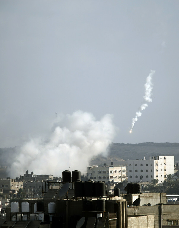 . A picture shows a flare and rising smoke following a missile fired by Israeli aircraft on homes in Beit Lahia, in the northern of Gaza Strip, on July 16, 2014. New Israeli air and tank strikes in Gaza killed several people, medics said, bringing the death toll from Israel\'s operation in the besieged Palestinian territory to 205. AFP PHOTO/MOHAMMED ABED/AFP/Getty Images