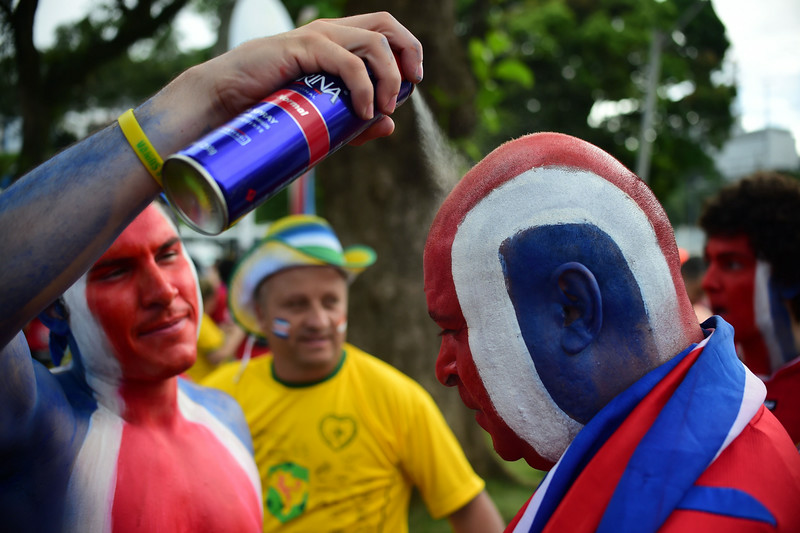 . Costa Rican supporters make themselves up in the national colours as they prepare to cheer for their team ahead of the quarter-final football match between Netherlands and Costa Rica at the Fonte Nova Arena in Salvador during the 2014 FIFA World Cup on July 5, 2014. (RONALDO SCHEMIDT/AFP/Getty Images)