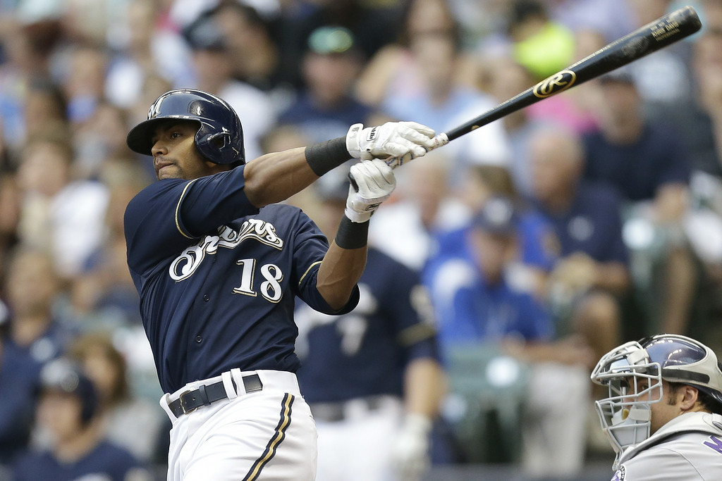 . MILWAUKEE, WI - JUNE 27: Khris Davis #18 of the Milwaukee Brewers hits a double in the bottom of the second inning against the Colorado Rockies at Miller Park on June 27, 2014 in Milwaukee, Wisconsin. (Photo by Mike McGinnis/Getty Images)