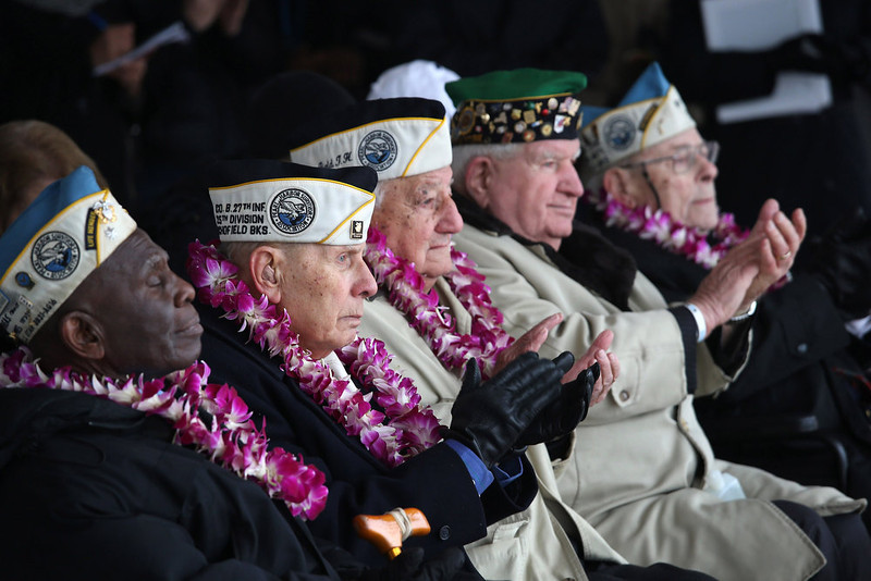 . Pearl Harbor survivors attend a ceremony commemorating the 71st anniversary of the Japanese attacks on Pearl Harbor on December 7, 2012 in New York City. World War II veterans from the New York metropolitan area participated in a wreath-laying ceremony next to the Intrepid Sea, Air and Space Museum, which was damaged in Hurricane Sandy and is undergoing repairs.  (Photo by John Moore/Getty Images)
