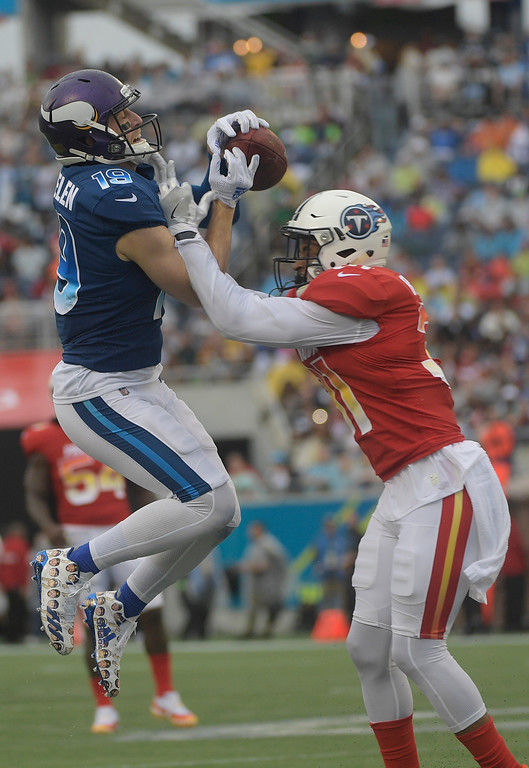 . AFC safer Kevin Byard (31), of the Tennessee Titans, breaks up a pass intended for NFC wide receiver Adam Thielen (19), of the Minnesota Vikings, during the first half of the NFL Pro Bowl football game, Sunday, Jan. 28, 2018, in Orlando, Fla. (AP Photo/Phelan M Ebenhack)